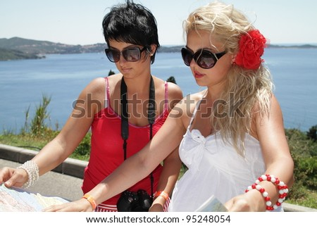 Two woman looking on a map