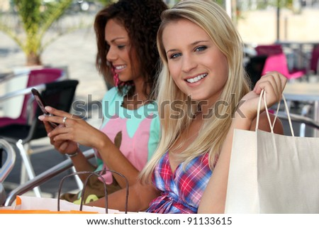Two woman on shopping trip - stock photo