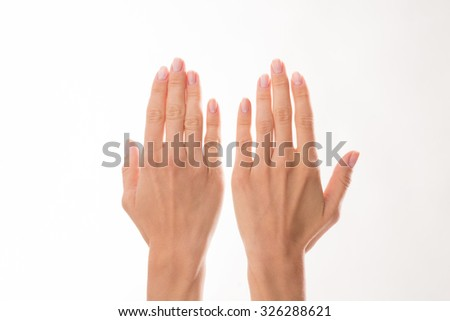 Two woman's hands are represented over white background. Woman showing her hands to demonstrate delicate skincare.