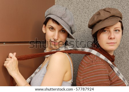 two woman's outdoor portrait - stock photo