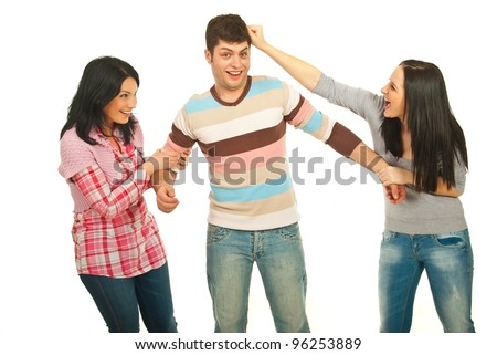Two women and man having fun and the women argue on man isolated on white background - stock photo