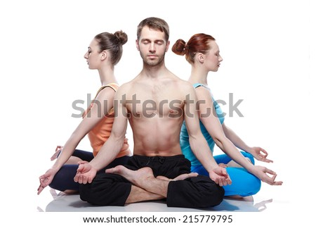two women and one man in meditation - stock photo
