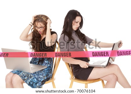 Two women are frustrated on there computers. - stock photo
