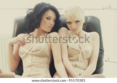 Two women are playing - stock photo