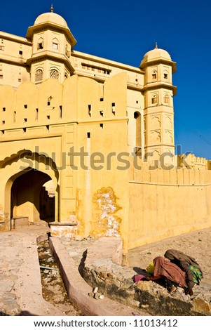 Two women at the Amber Fort, Jaipur, Rajasthan, India. - stock photo