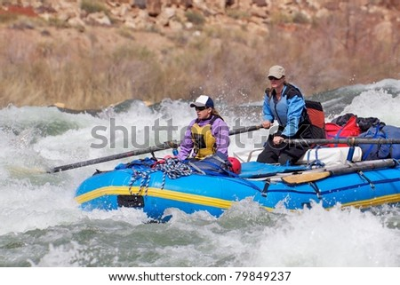 Two Women Challenging a Rapid - Grand Canyon National Park