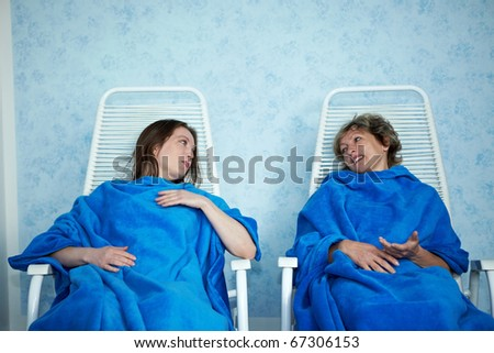 Two women chatting after a spa treatment - stock photo
