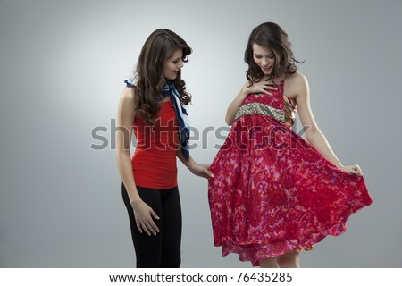 two women choosing flowers red dress - stock photo