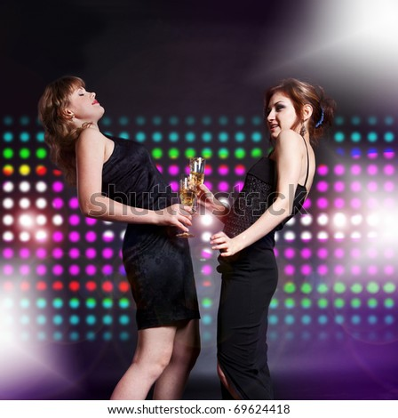 two women dancing on the disco party