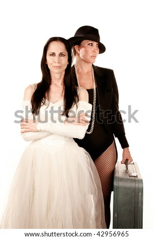 Two women dressed as traditional bride and groom - stock photo