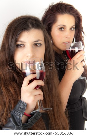 Two women drinking wine - stock photo