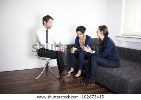 Two women during therapy session - stock photo