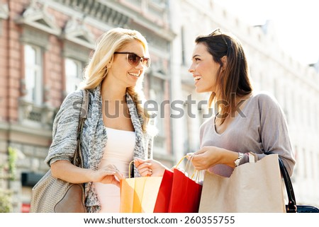 Two women enjoy shopping - stock photo