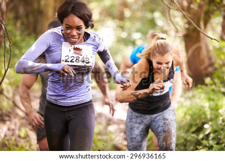 Two women enjoying a run in a forest at an endurance event - stock photo