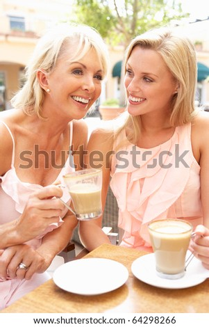 Two Women Enjoying Cup Of Coffee In Cafe - stock photo