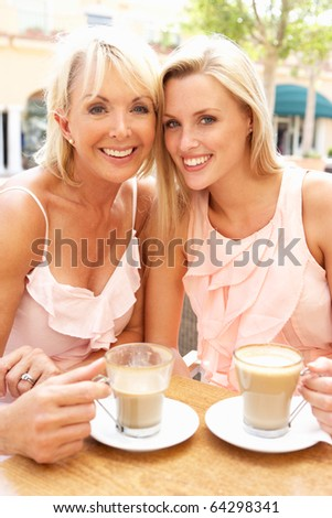 Two Women Enjoying Cup Of Coffee In Cafe