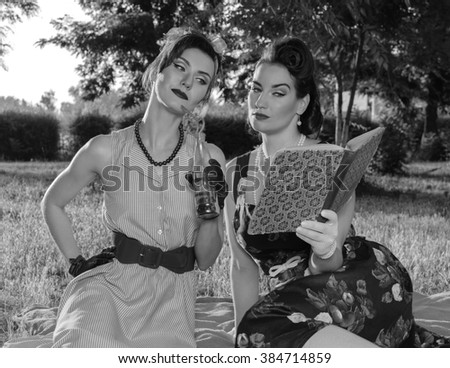 Two women fashionista - stock photo
