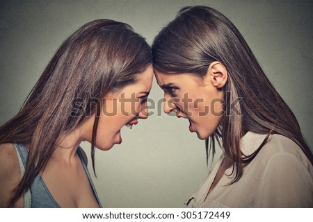 Two women fight. Angry women, looking at each other with hatred, blaming for problem. Friendship difficulties, problems at work concept  - stock photo