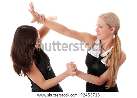 Two women fight, isolated on white background - stock photo
