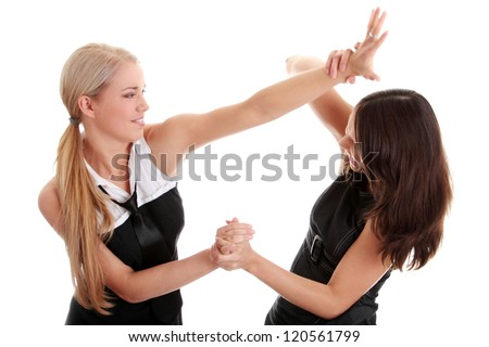 Two women fighting, isolated on white background - stock photo