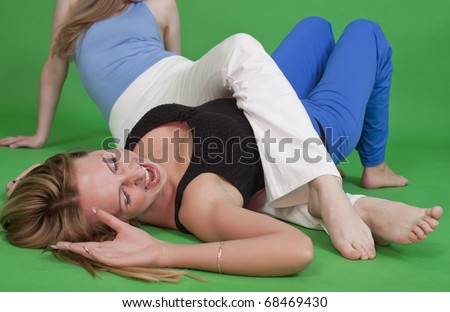 two women fighting on the ground - judo hold - stock photo