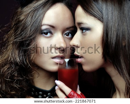 Two women in fancy carnival costumes. Devil shape. - stock photo