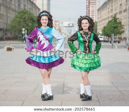 Two women in irish dance dresses  - stock photo