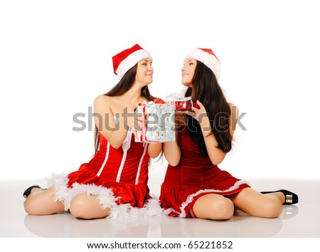 two women in santa claus dresses isolated on white, may be use for xmas cards and posters