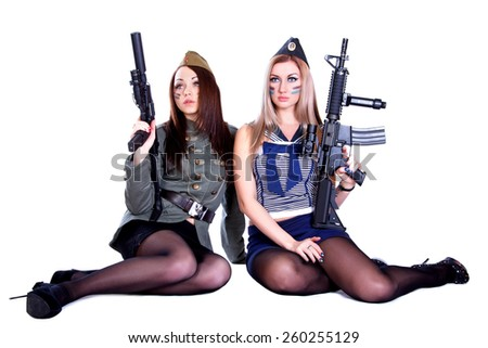 Two women in the military uniform with guns isolated over white background - stock photo