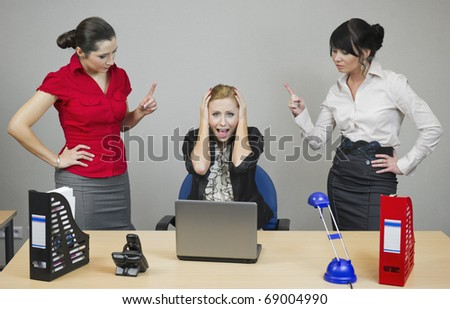 Two women in the office monitor your colleague at work