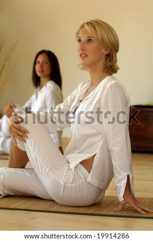 Two women in yoga position - stock photo