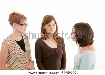 Two women listening to another with worried expressions - stock photo
