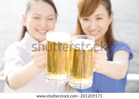 Two women making a toast on terrace