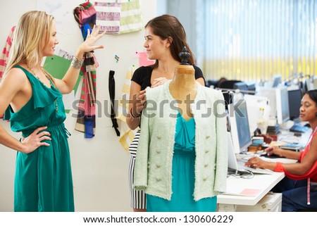 Two Women Meeting In Fashion Design Studio - stock photo