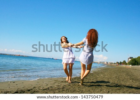 Two women on beach in Limassol, Cyprus.