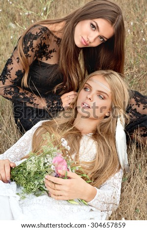 Two women on sunset outdoor. Boho style. Series - stock photo
