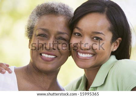 Two women outdoors smiling - stock photo