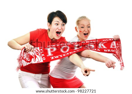 Two women - Polish soccer fans. Dressed in Polish national color and scarfs. - stock photo