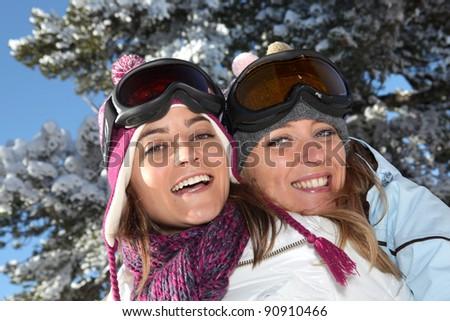 Two women ready to ski - stock photo