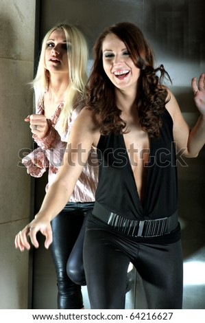 Two women running from the elevator