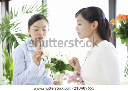 Two women seeing flowers