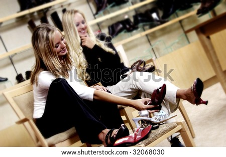 Two women shoe shopping - stock photo