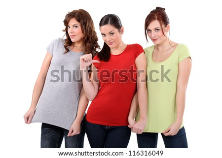 two women showing their t-shirts, one woman pointing finger toward herself