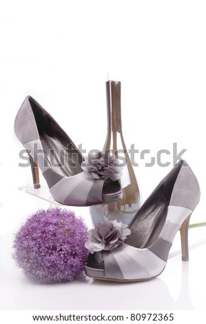 Two women silver shoes composition - stock photo