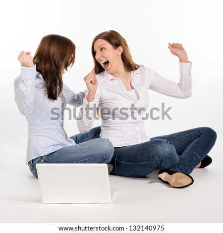 two women sitting on the flor and cheering - stock photo