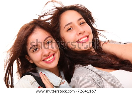 Two women smiling at the camera over white background - stock photo
