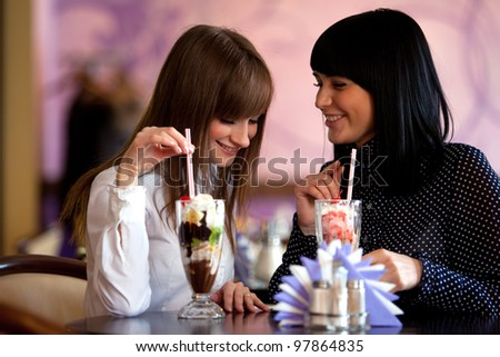 two  women speaking in caffee - stock photo