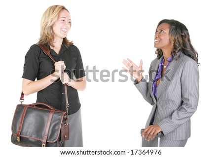 Two women standing and talking on isolated white background. - stock photo