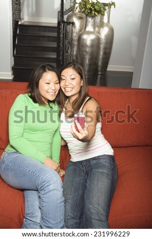 Two Women Taking Photo of Themselves - stock photo