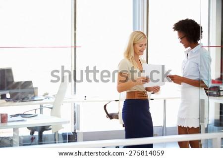 Two women talking in a modern office - stock photo